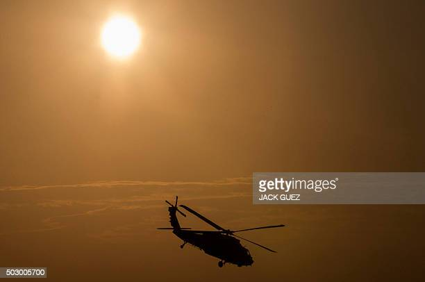 An Israeli UH60 Black Hawk takes part in an air show for a graduation ceremony at the Hatzerim base in the Negev desert near the southern Israeli...