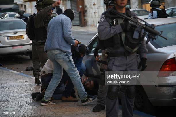 An Israeli undercover police officer detains a Palestinian man during a protest against US President Donald Trumps announcement to recognize...