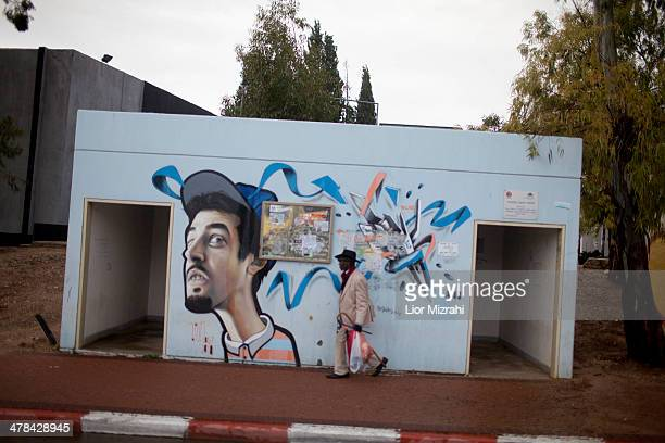An Israeli walks next to a bomb shelter on March 13, 2014 in Sderot, Israel. Israeli air forces attacked seven sites in the Gaza Strip this afternoon...