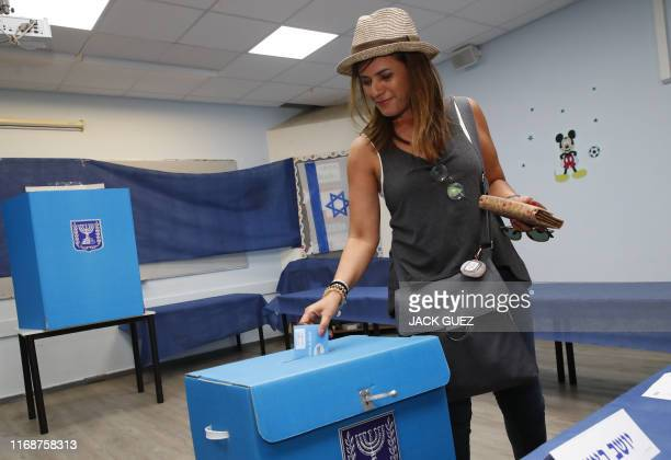 An Israeli woman casts her ballot during Israel's parliamentary election at a polling station in Rosh Haayin on September 17 2019