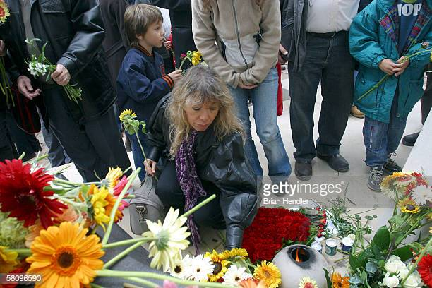 An Israeli woman lays flowers at the graves of assassinated Israeli Prime Minister Yitzhak Rabin and his wife Leah Rabin in the Great Leaders Of The...