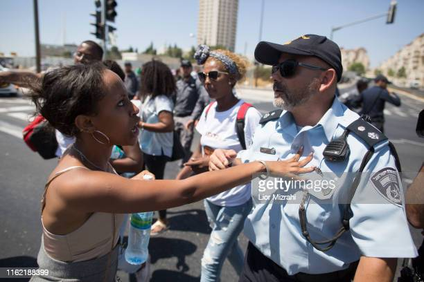 An Israeli woman of Ethiopian origin argues with an Israeli police man during a protest outside the Knesset on July 15 2019 in Jerusalem Israel The...