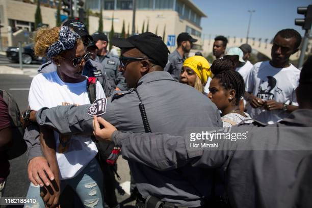 An Israeli woman of Ethiopian origin speaks with an Israeli police officer during a protest outside the Knesset on July 15 2019 in Jerusalem Israel...