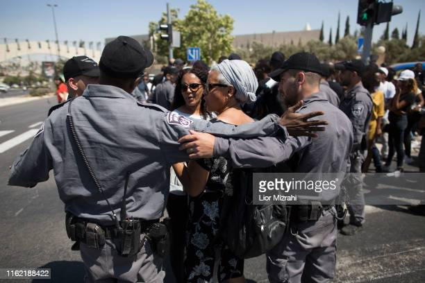 An Israeli woman of Ethiopian origin speaks with Israeli police officers during a protest outside the Knesset on July 15 2019 in Jerusalem Israel The...