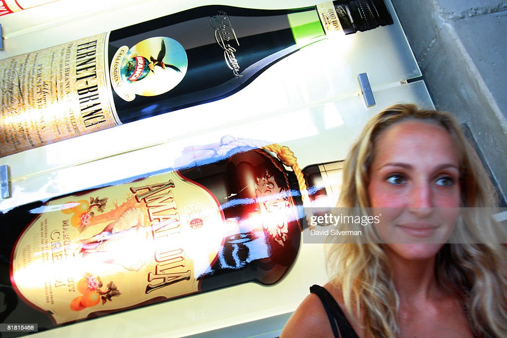 An Israeli woman passes an advert for imported liquers at the first Barman's festival held for food and drink professionals on July 1, 2008 in Tel Aviv, Israel. For three nights, Israel's bar and restaurant staff were treated to cocktails and testing's of some of the best imported vodkas, whiskies and beers imported into the Jewish State.