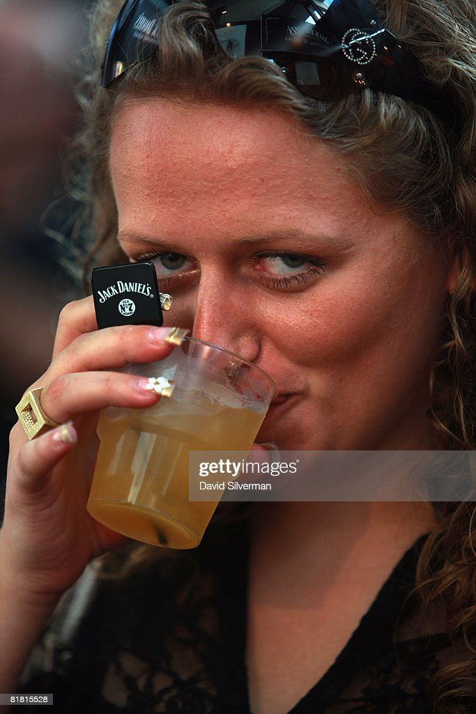 An Israeli woman sips on her Jack Daniels cocktail at the first Barman's festival held for food and drink professionals on July 1, 2008 in Tel Aviv, Israel. For three nights, Israel's bar and restaurant staff were treated to cocktails and testing's of some of the best imported vodkas, whiskies and beers imported into the Jewish State.