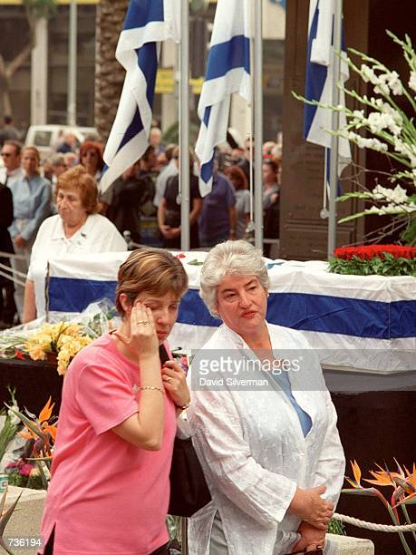 An Israeli woman wipes away her tears as she passes the flag-draped coffin of Leah Rabin, wife of assassinated former Prime Minister Yitzhak Rabin,...