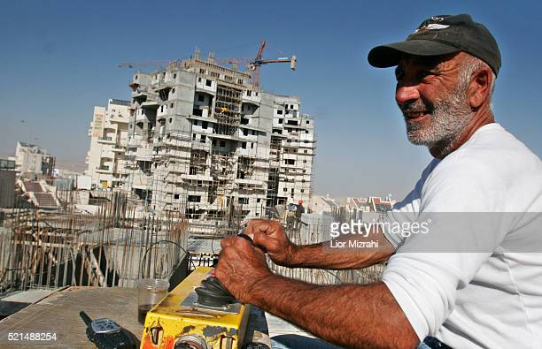 An Israeli worker at a construction site in the West Bank settlement of Maale Adumin Tuesday November 21 2006. A new study conducted by left-wing...