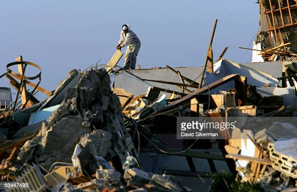 PE'AT SADEH GAZA STRIP AUGUST 21 An Israeli worker removes asbestos roofing from a destroyed home after it was bulldozed into the ground during the...