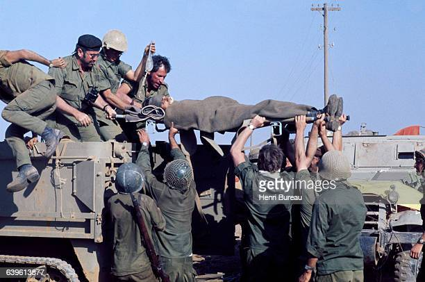 An Israelian soldier is wounded during the Yom Kippur War in the region of Golan Heights
