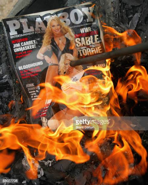 An issue of Playboy magazine burns as the men of First Cavalry Task Force 19 hand over their pornography in order to comply with US Army regulations...