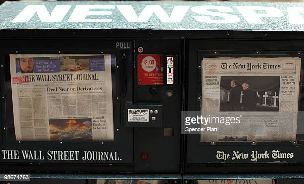 An issue of The Wall Street Journal is viewed beside The New York Times on April 26, 2010 in New York City. The Wall Street Journal commenced a New...