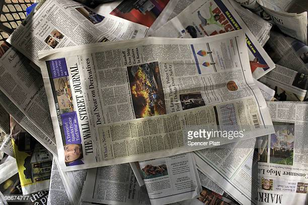 An issue of The Wall Street Journal is viewed in a recycling container in Grand Central Terminal on April 26 2010 in New York City The Wall Street...