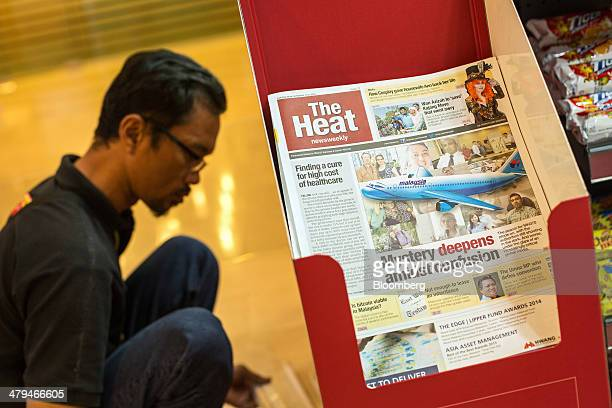 An issue of the weekly newspaper The Heat is displayed for sale in a store in Kuala Lumpur, Malaysia, on Tuesday, March 18, 2014. Malaysia, aspiring...