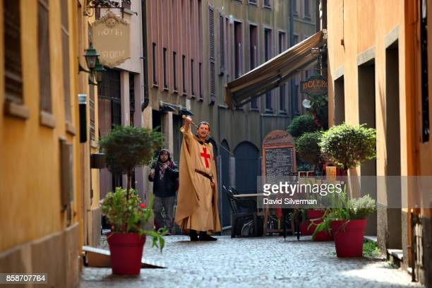 An Italian actor dressed an a medieval knight draws his sword outside the Bar ''Bolero'' di Minotauro on March 25 2017 in Cremona in the Italian...