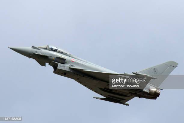 An Italian Air Force F-2000 Typhoon performs during the International Air Tattoo at RAF Fairford on July 21, 2019 in Fairford, England. The Royal...