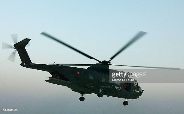 An Italian Air Force HH-3F helicopter from the Italian Joint Task Force flies near the Italian base Camp Mittica on October 10, 2004 in Nasiriyah in...