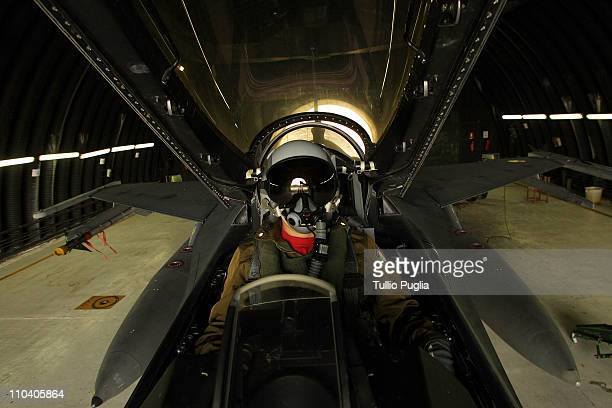 An Italian Air Force pilot completes checks to a F16 plane before a flight mission at Birgi Italian Air Force Base on October 05 2006 in Trapani...