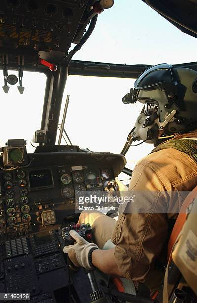 An Italian Air Force pilot from the Italian Joint Task Force Iraq, 6? ROA, flys a HH-3F helicopter near his base Camp Mittica on October 10, 2004 in...