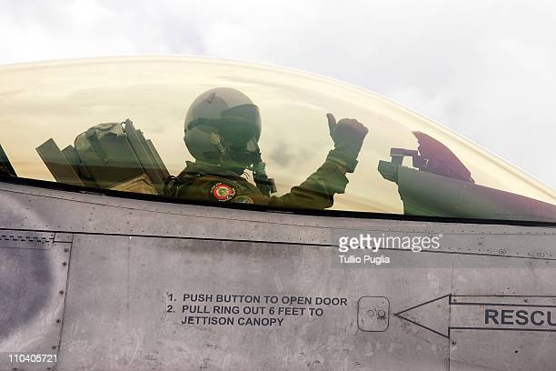 An Italian Air Force pilot gestures in a F16 plane cockpit before take off at Birgi Italian Air Force Base on October 05 2006 in Trapani Italy After...