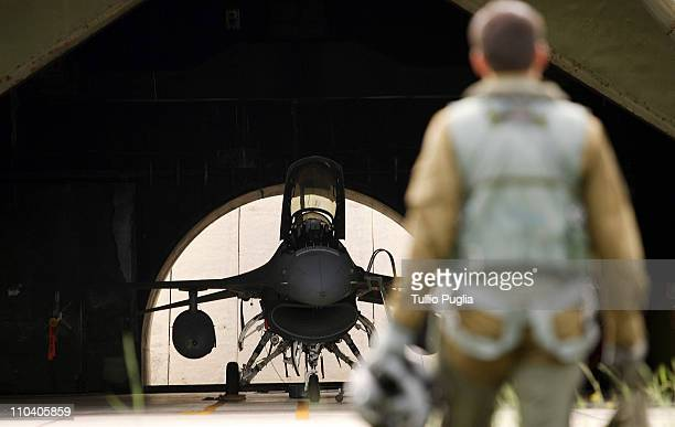 An Italian Air Force pilot walks to a F16 plane before a flight mission at Birgi Italian Air Force Base on October 05 2006 in Trapani Italy After the...