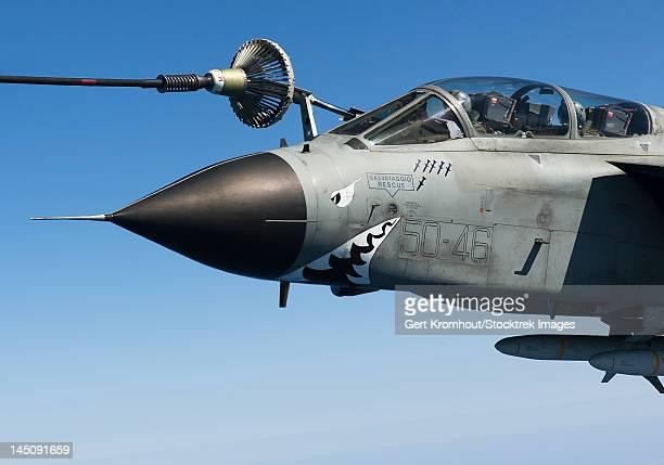 An Italian Air Force Tornado IDS conducts in-flight refueling.