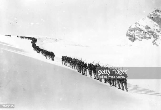 An Italian Alpine Regiment move up the Rurtor Glacier