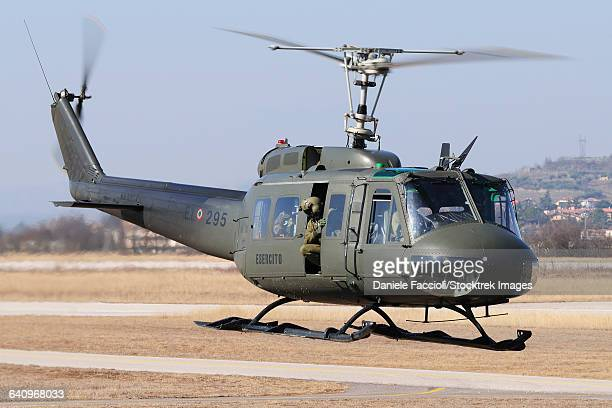 An Italian Army AB-205 helicopter taking off for a training mission over Italy.
