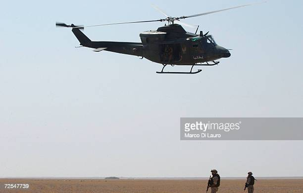 An Italian Army AB-412 helicopter flyes over the desert during Operation 'Strong Hammer' on October 12, 2004 in Nasiriyah, southern Iraq. The task of...