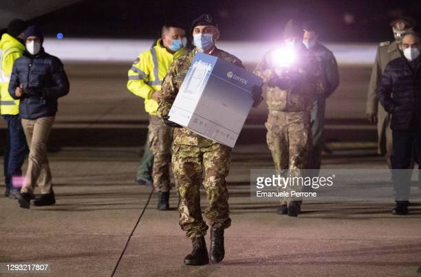 An Italian army soldier carries 180 doses of Pfizer vaccine as soon as they arrive at Cagliari airport on December 26, 2020 in Cagliari, Italy. An...
