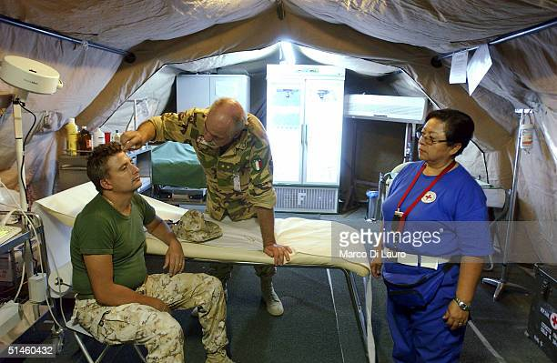An Italian Army soldier from the Italian Joint Task Force Iraq, Brigata Friuli, receives medical treatment from an Italian Army doctor at his base,...