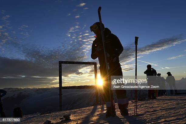 An Italian athlete at the top of the Rettenbach glacer as the sun rises during the Audi FIS Alpine Ski World Cup Men's Giant Slalom on October 23...