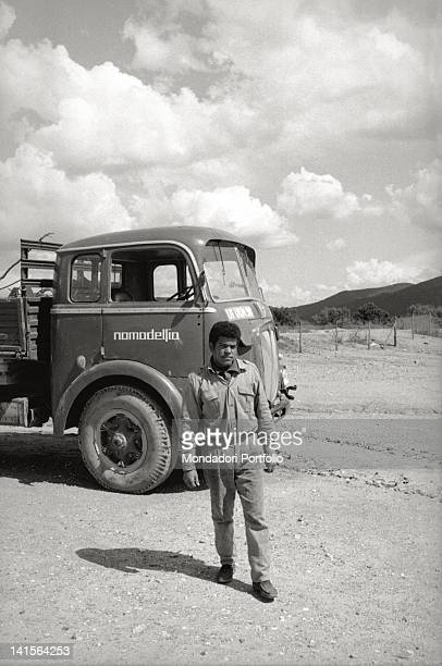 An Italian boy of the community of Nomedelfia dealing with motor transport Nomadelfia is a community for young orphans founded in 1934 by Don Zeno...