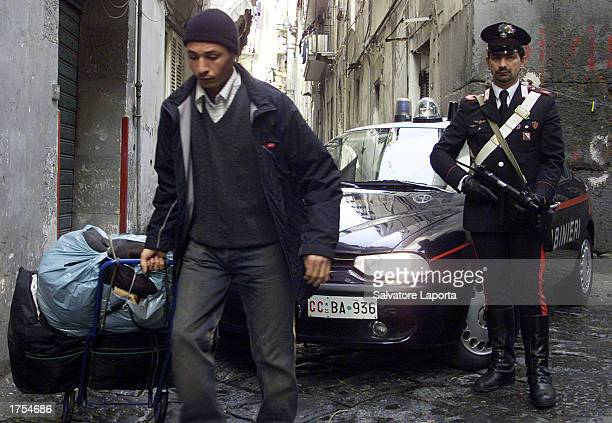 An Italian carabiniere patrols the streets where 28 Pakistani were arrested January 31 2003 in Naples Italy Large quantities of explosives forged...