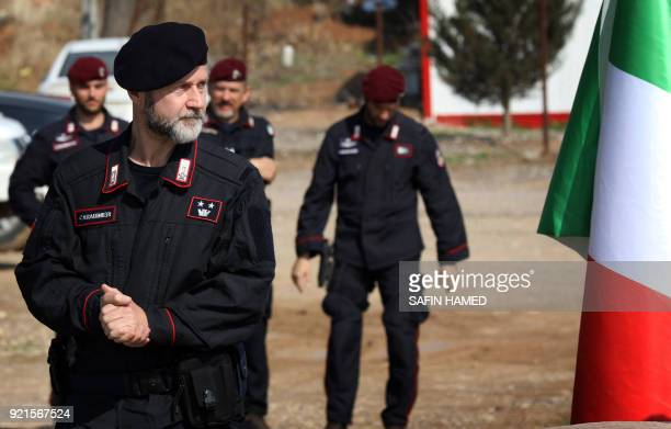 An Italian Carabinieri commander looks on during a graduation ceremony for Iraqi Kurdish Peshmerga fighters who completed a VIP bodyguard training...
