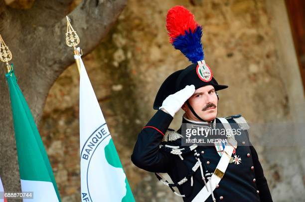 An Italian carabinieri stands guard at the Hotel San Domenico on the second day of the G7 summit of Heads of State and of Government on May 27 2017...