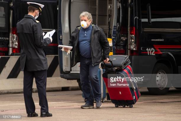 An Italian citizen at customs checks after disembarking from the Catania ship during the covid19 emergency on April 6 2020 in Salerno Italy The...