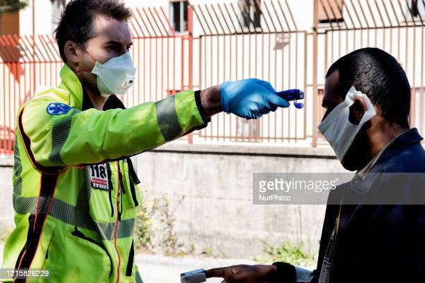 An Italian doctor of 118 check the state of health of a migrant in the police station of the Italian border town Fernetti to prevent the spread out...