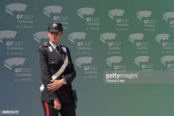 An Italian female carabinieri stands at the entrance of the ancient Greek Theater before the arrival of the Heads of State and of Government for the...