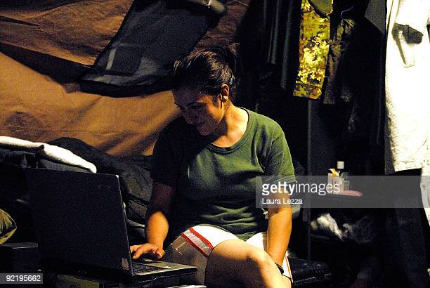 An Italian female paratrooper soldier of the Folgore Parachute Brigade surfs the net in her tent at night time on September 16 2009 in Shindand...
