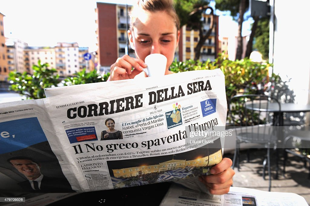 An Italian girl reads one of the major Italian newspapers which has run with the headline 'The Greeks Do Not Scare Europe' the day after Greece's austerity referendum which dominates the Italian front pages today, on July 6, 2015 in Livorno, Italy. Greeks voted in a strong majority against the reform plan proposed by the Troika, with Italian newspapers highlighting Prime Minsiter Alexis Tsipras's clear victory with the 'No' campaign.
