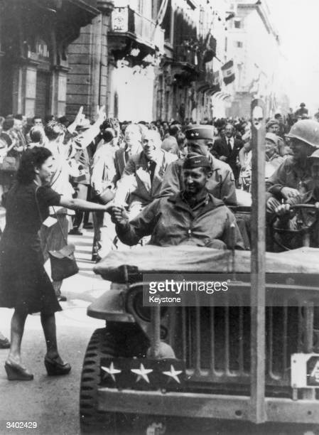 An Italian girl shakes hands with US Lieutenant General Mark Clark , commander of the Allied 5th Army, as he tours Rome a day after the Italian...