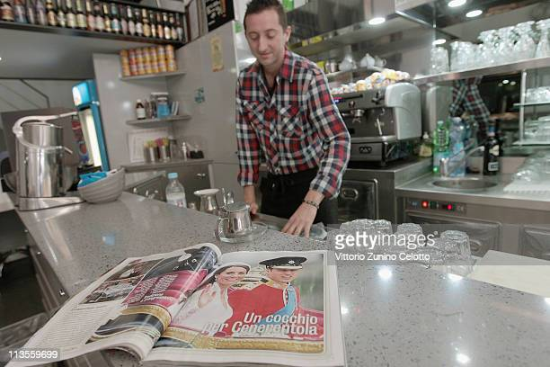 An Italian magazine that shows pictures of the the Royal Highnesses Prince William Duke of Cambridge and Catherine Duchess of Cambridge is seen on...