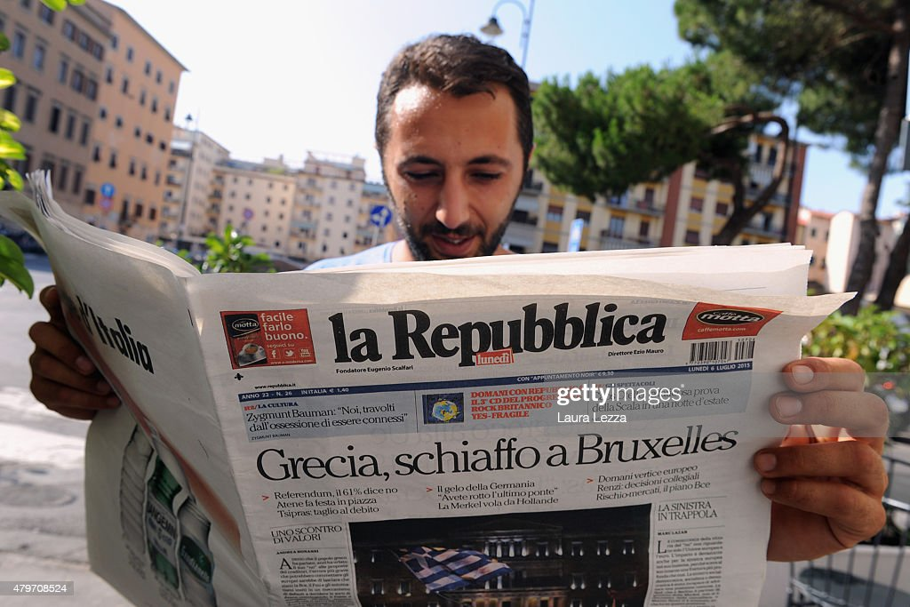 An Italian man reads one of the major Italian newspapers which has run with the headline 'Greece Slap Brussels' the day after Greece's austerity referendum which dominates the Italian front pages today, on July 6, 2015 in Livorno, Italy. Greeks voted in a strong majority against the reform plan proposed by the Troika, with Italian newspapers highlighting Prime Minsiter Alexis Tsipras's clear victory with the 'No' campaign.