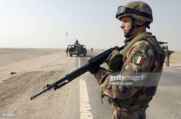 An Italian marine from the Italian Joint Task Force Iraq, San Marco Regiment, stands at a check point on the Tampa road from Basrah to Baghdad near...