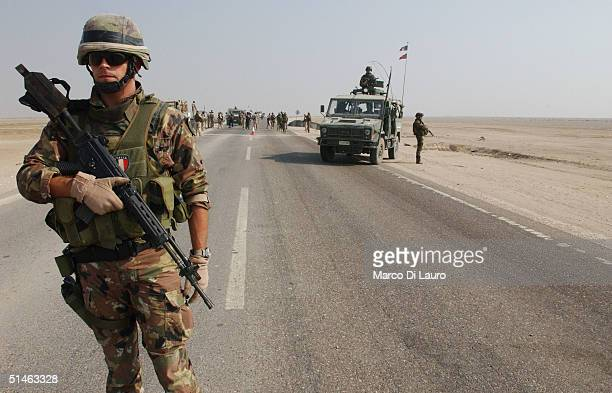 An Italian marine from the Italian Joint Task Force Iraq, San Marco Regiment, stands with his Beretta SC 70/90 rifle at a check point on the Tampa...