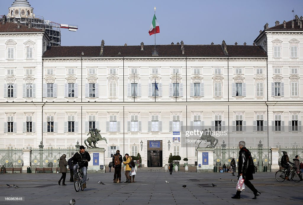 An Italian national flag flies from the roof of a building on Castle Square in Turin, Italy, on Tuesday, Jan. 29, 2013. Italy sold 8.5 billion euros ($11.4 billion) of six-month Treasury bills as rates dropped to the lowest in almost three years as the European Central Bank's pledge to buy bonds continues to provide an effective backstop even amid rising political concerns. Photographer: Alessia Pierdomenico/Bloomberg via Getty Images