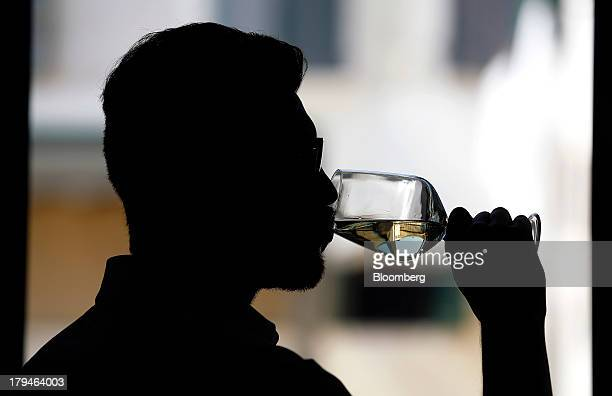 An Italian oenologist tests a glass of Prosecco wine for authenticity at a restaurant in Treviso Italy on Tuesday Sept 3 2013 Italy's Agriculture...