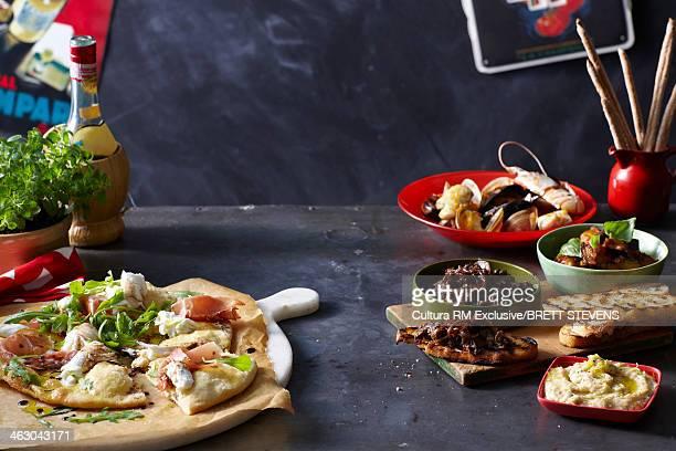 An Italian Opener - Basil, Prosciutto, Olives, Crusty Bread, Bocconcini, Pizza, Antipasti, Grizzini, Vongole, Marron, Olive Oil