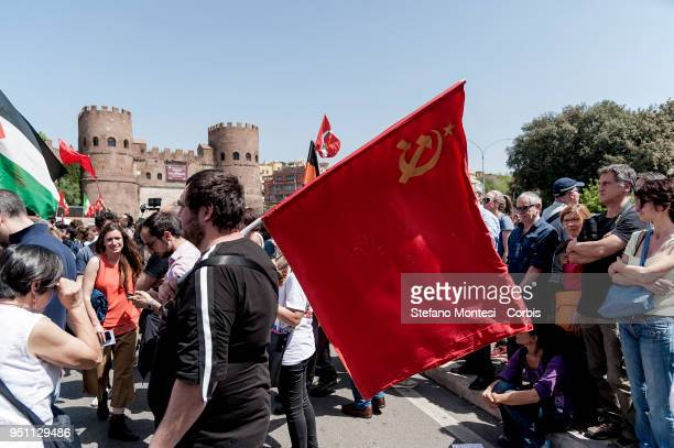 An Italian partisan carries a Communist flag during a rally to celebrate the 73rd Liberation Day on April 25 2018 in Rome Italy Italy's Liberation...
